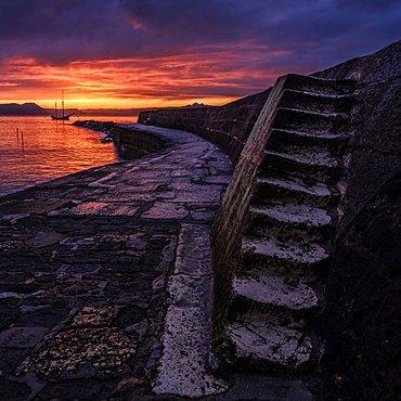 Twilight with Irene anchored off The Cobb in Lyme Regis, Dorset, UK