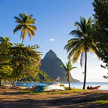 View from palm-fringed beach across Soufriere Bay to Petit Piton, evening, Soufriere, St. Lucia, Windward Islands, Lesser Antilles, West Indies, Caribbean, Central America