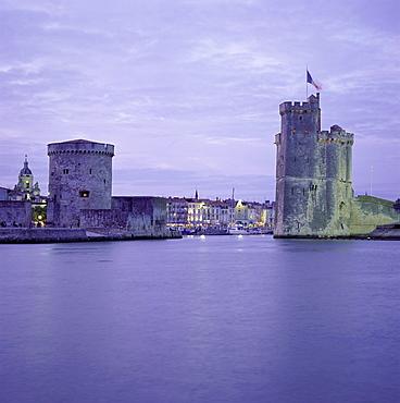 Harbour entrance with Tour de la Chaine on left and Tour St. Nicolas (St. Nicholas Tower) on right, La Rochelle, Poitou Charentes, France, Europe