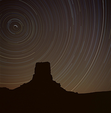 Star tracing over Monument Valley, tracing stars moving round the North Star, Monument Valley, an area in Utah and Arizona, United States of America (U.S.A.), North America