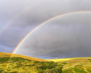 Double rainbow over meadow landscape, near Pennan, Aberdeenshire, Scotland, Great Britain