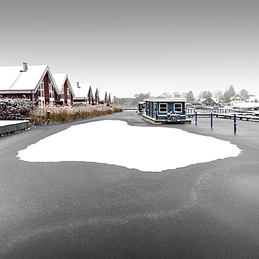 Snowy houseboat on the Scharmuetzelsee, Germany, Europe