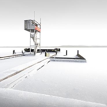 Snowed-in rescue tower in frozen Mueggelsee, Berlin, Germany, Europe