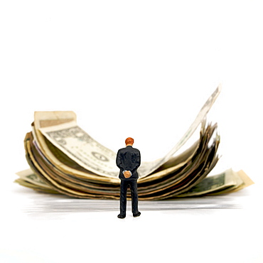 Businessman and pile of banknotes