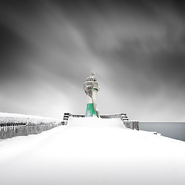 Iced lighthouse in the harbour of Sassnitz, Ruegen, Germany, Europe