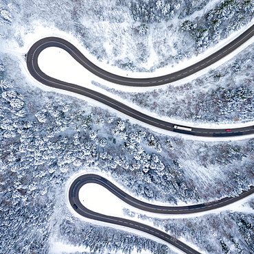 Winter snow road serpentine curves Lochenpass forest aerial photo way square curve, Germany, Europe