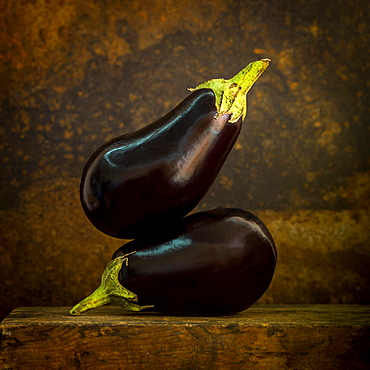 Eggplants on a brown background