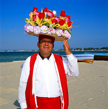 Flower seller on the beach, Hammamet, Cap Bon, Tunisia, North Africa, Africa