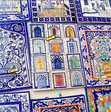 Tiles decorated with Tunisian doorways on souvenir stall, Hammamet, Cap Bon, Tunisia, North Africa, Africa