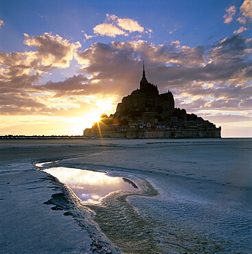 Mont Saint-Michel from the tidal flats at sunset, Mont Saint-Michel, UNESCO World Heritage Site, Normandy, France, Europe