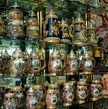 Souvenir shop window display of traditional Austrian beer tankards, Vienna, Austria, Europe