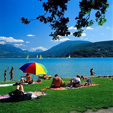 Sunbathers along shore of Lake, Annecy, Lake Annecy, Rhone Alpes, France, Europe