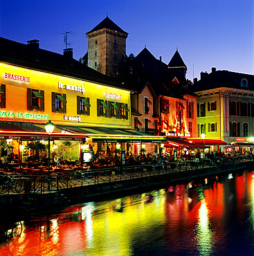 Canal side restaurants below the Chateau at dusk, Annecy, Lake Annecy, Rhone Alpes, France, Europe