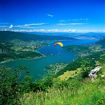 View over lake with paraglider, Lake Annecy, Rhone Alpes, France, Europe