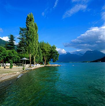 View along lake shore, Talloires, Lake Annecy, Rhone Alpes, France, Europe