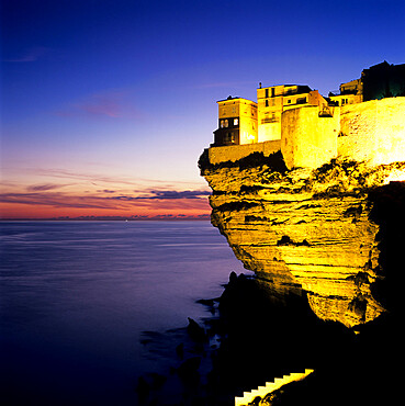 Haute Ville on cliff edge at dusk, Bonifacio, South Corsica, Corsica, France, Mediterranean, Europe