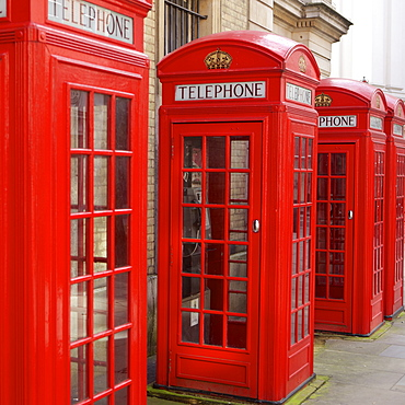 Row of red telephone booths design by Sir Giles Gilbert Scott, near Covent Garden, London, England, United Kingdom, Europe
