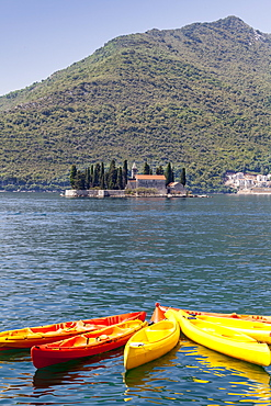 View of St. George Island with kayaks in the foreground, Perast, Bay of Kotor, UNESCO World Heritage Site, Montenegro, Europe