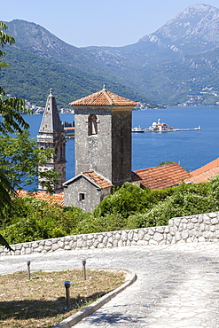 St. Nicholas Church and St. George's Island in the background, Perast, Bay of Kotor, UNESCO World Heritage Site, Montenegro, Europe