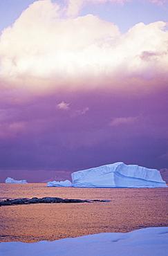Sunset over iceberg, Gerlache Strait, Antarctica, Southern Ocean.