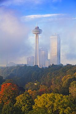 Mist from Horseshoe Falls swirling in front of Skylon Tower at dawn, Niagara Falls, Niagara, Ontario, Canada, North America
