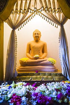 Temple of the Sacred Tooth Relic (Sri Dalada Maligawa), Buddha statue in a lotus position, Kandy, Sri Lanka, Asia