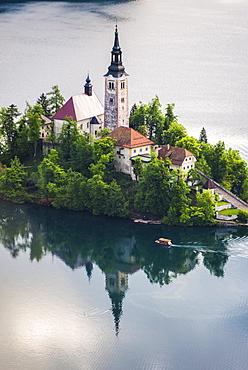 Lake Bled boat (Pletna) at Lake Bled Island at sunrise, Gorenjska, Slovenia, Europe