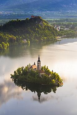 Lake Bled Island and Bled Castle at sunrise, Julian Alps, Gorenjska, Slovenia, Europe