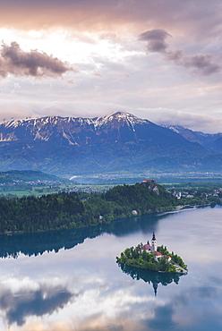 Lake Bled Island and the Julian Alps at sunrise, seen from Osojnica Hill, Bled, Julian Alps, Gorenjska, Slovenia, Europe