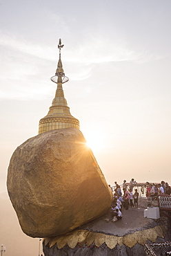 Pilgrims at Golden Rock Stupa (Kyaiktiyo Pagoda) at sunset, Mon State, Myanmar (Burma), Asia