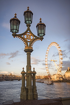 The London Eye at sunset, seen from Westminster Bridge, South Bank, London, England, United Kingdom, Europe