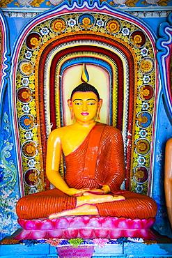 Colourful Buddha statue at Isurumuniya Vihara, Anuradhapura, UNESCO World Heritage Site, Sri Lanka,Asia