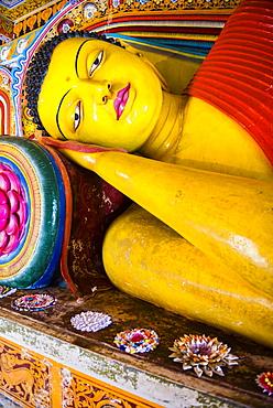 Colourful reclining Buddha statue at Isurumuniya Vihara, Anuradhapura, UNESCO World Heritage Site, Sri Lanka,Asia