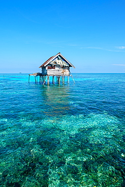 Huts built over the water by the Bajau Fishermen who live there three months of the year, Togian Islands, Indonesia, Southeast Asia, Asia