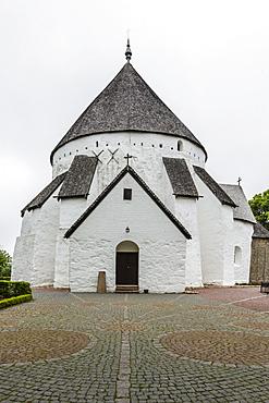 Exterior view of the 13th century circular design Osterlars Church, Bornholm, Denmark, Scandinavia, Europe