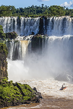 A river boat at the base of the falls, Iguazu Falls National Park, UNESCO World Heritage Site, Misiones, Argentina, South America