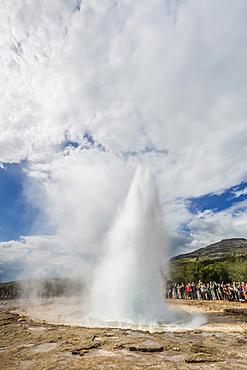 Tourists gather to watch Strokker geyser (geysir), an erupting spring at Haukadalur, Iceland, Polar Regions