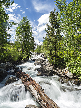 Snow melt cascades leading to Taggart Lake, Grand Teton National Park, Wyoming, United States of America, North America