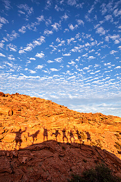 Peoples shadows on wind formed sandstone formations at Los Gatos, Baja California Sur, Mexico, North America.