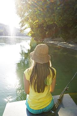 Teenage girl at river Rhine, Rheinfelden, Baden-Wuerttemberg, Germany