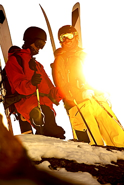 Two freeskiers standing on the top of a mountain, Chandolin, Canton of Valais, Switzerland