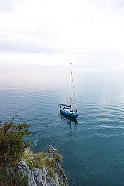 Sailing boat anchoring near coast, Gulf of Trieste, Gorizia, Friuli Venezia Giulia, Italy