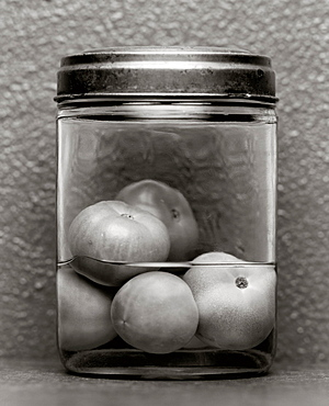 Green tomatoes preserved in a jar, Food