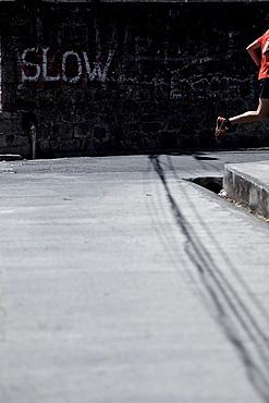 Young man running along a street, Dominica, Lesser Antilles, Caribbean