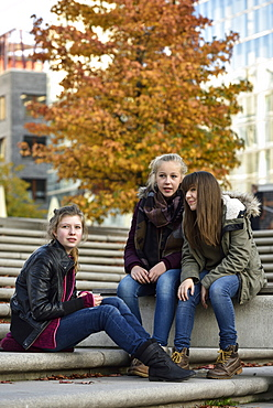 3 girls chatting outside in Hafencity, Hamburg, Germany, Europe