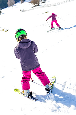 girl and boy during skiing the slope , Pfronten, Allgaeu, Bavaria, Germany
