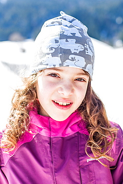 Portrait of a girl while sledging, Pfronten, Allgaeu, Bavaria, Germany