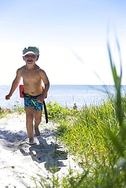 Boy, 5 years old, on the beach, dream beach between Strandmarken und Dueodde, sandy beach, summer, Baltic sea, Bornholm, Strandmarken, Denmark, Europe, MR