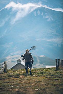 Old mountain farmer on the way to the mountain hut, Switzerland, mountains, farmer,