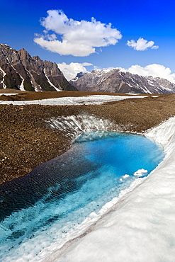 Glacial lake on Kennicott Glacier, with Wrangell Mountains in background, in summer, Wrangell–St. Elias National Park and Preserve, Alaska, United States of America